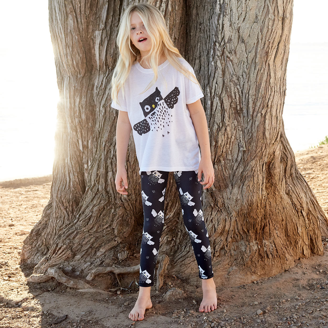 Owls Sunblock Youth Leggings Upf50 Girls Size 6 12 Black _ White Girl Checking The Surf At The Beach Sunpoplife