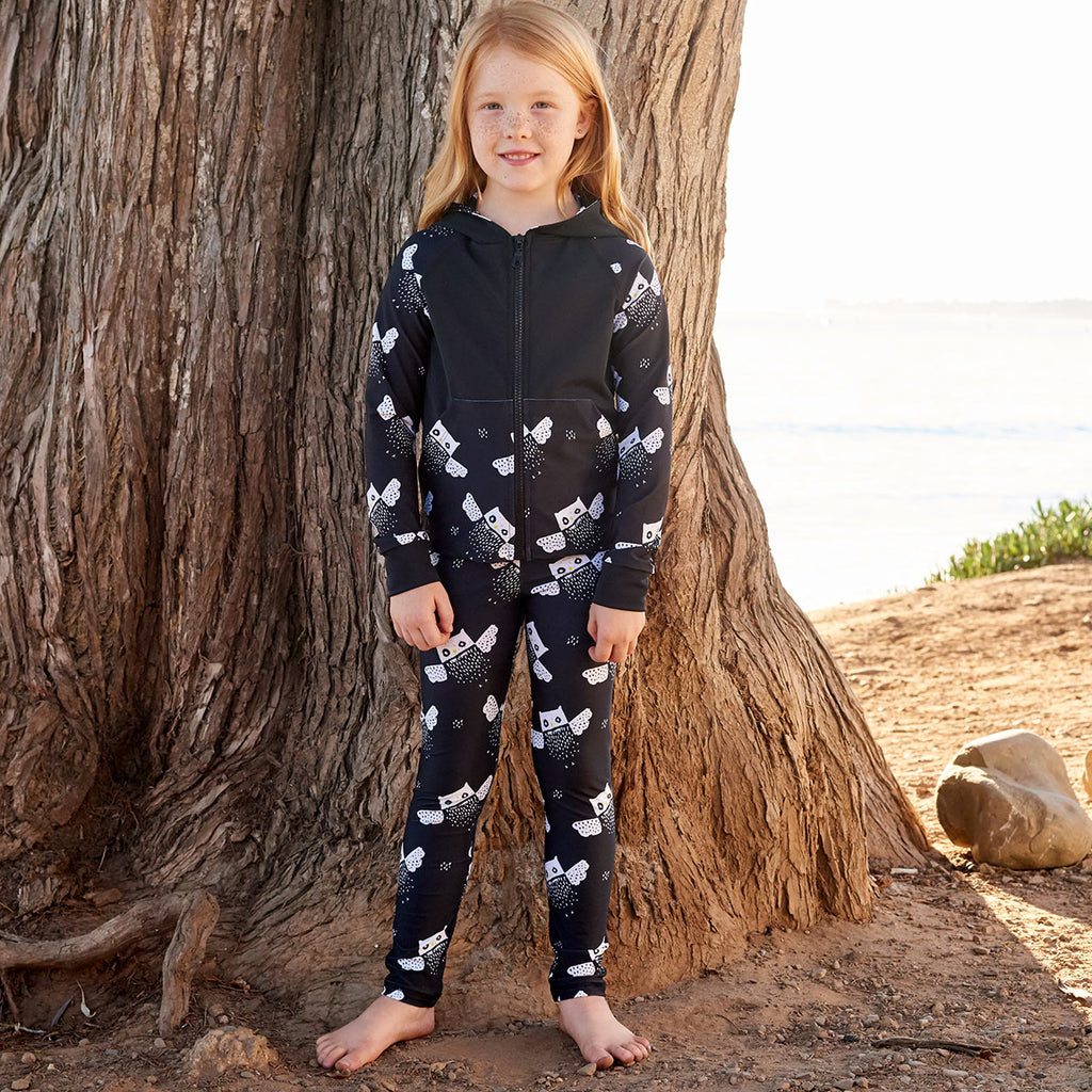 Owls Sunblocker Leggings Upf50 Black White Unisex Boys Girl Size 2 6 Girl Wearing An Athleisure Outfit Standing By The Beach Sunpoplife