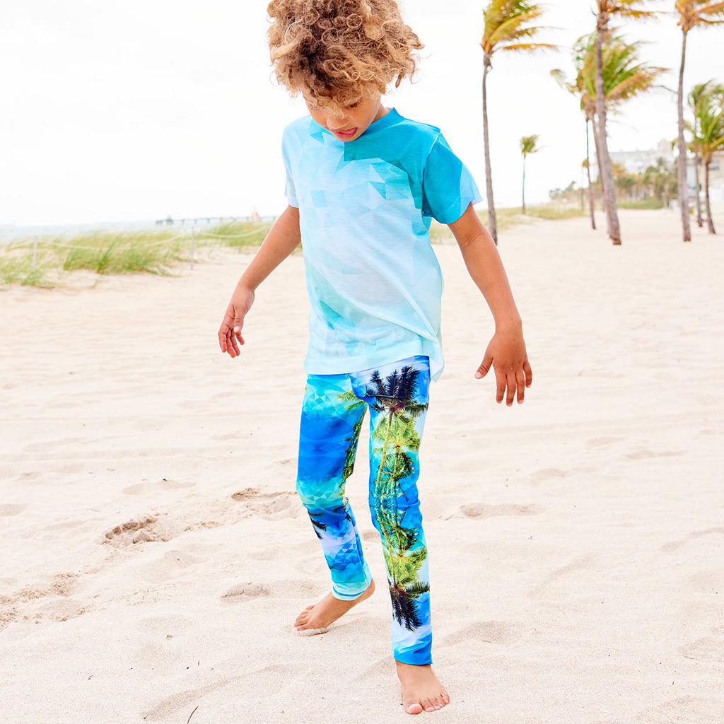 Palm Trees Hybrid Leggings Upf50 Kids Boys Girls Kids 2 6 Green Blue Unisex Geo Tropical Boy Wearing Sun Protective Leggings By The Beach Sunpoplife