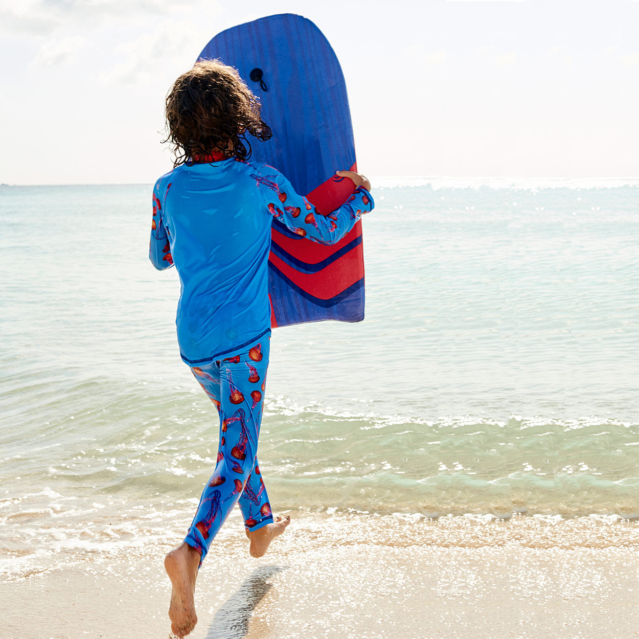 Red Jellyfish 2 Pc Rash Guard Set Boy With A Morey Boogie Board On The Beach Sunpoplife