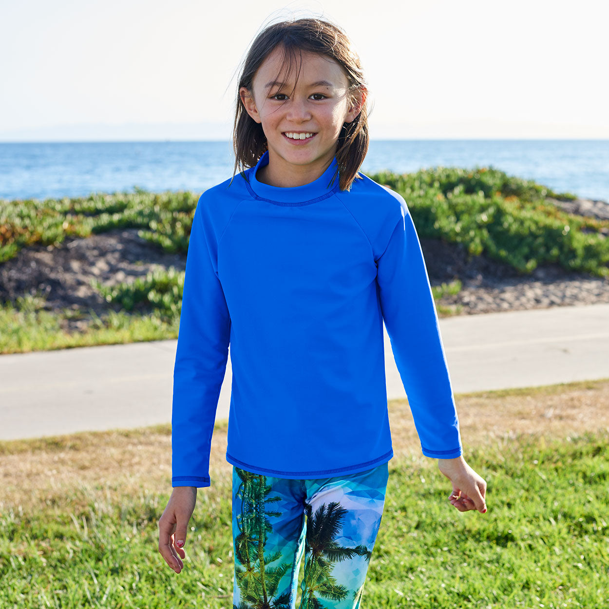 Royal Blue Kids Long Sleeve Rash Guard Top Upf50 Boys Girls Unisex Size 2 12 Girl Walking on the Grass Sunpoplife