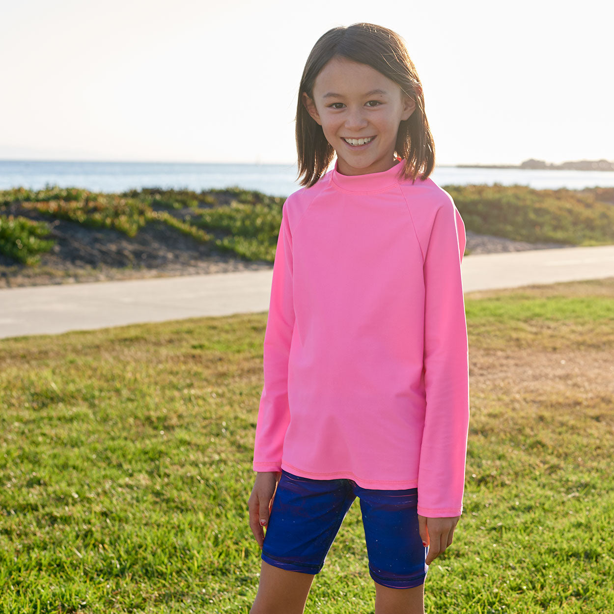 True Pink Girls Long Sleeve Rash Guard Top Upf50 Size 2 12 Girl Smiling Wearing a True Pink Top on the Park Sunpoplife