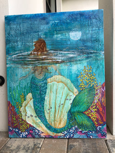 mermaid in the ocean reef blue and aqua water with fish coral and shells