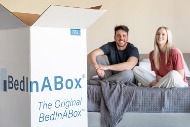 Couple on Bed with Mattress Box