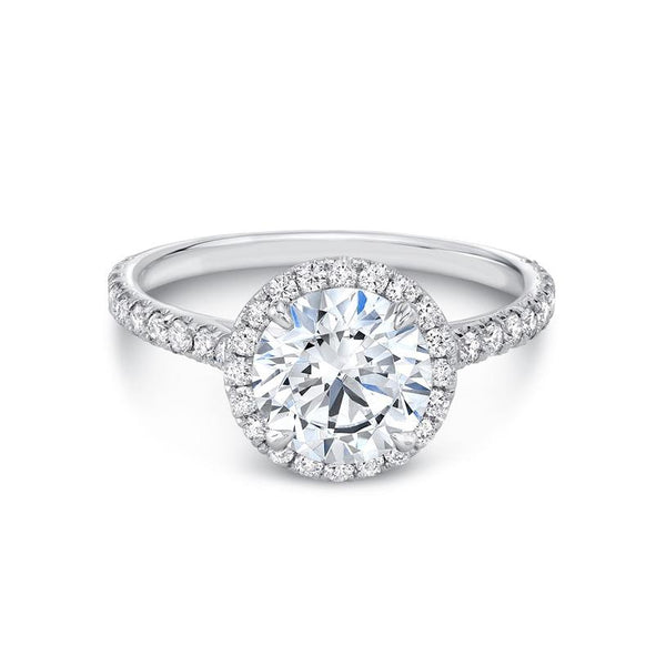 The ideal halo, the Alyssum Engagement Ring was designed with beauty, form and function in mind. A central diamond is held in place by four petal-shaped prongs, custom made to fit the diamond size and shape of your choice. A delicate row of Pave encircles the stone and continues around the band for maximum brightness and sparkle. This beautiful ring will sit flush with a wedding band.