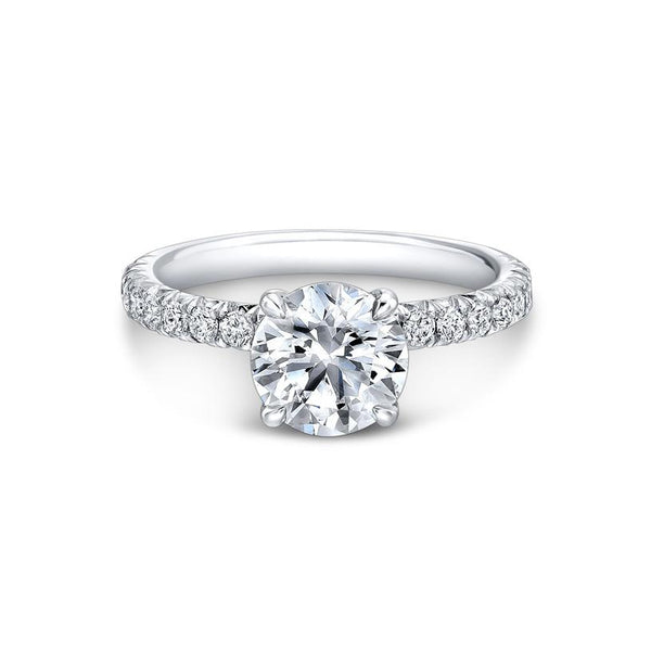 Set with four sleek, tapered prongs, the Four Pointed French Pave Engagement Ring elevates the diamond above the shank to create an extraordinary show of light. The French Pave diamond band enhances the striking magnificence of this piece.