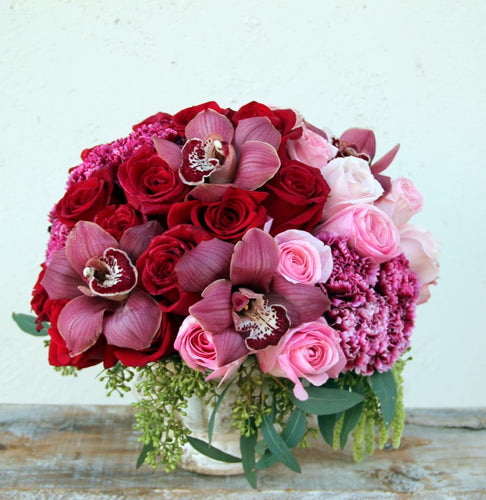 Red and Pink Roses and Orchids