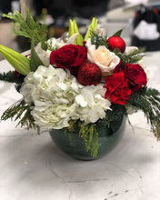 Christmas arrangement in a round vase