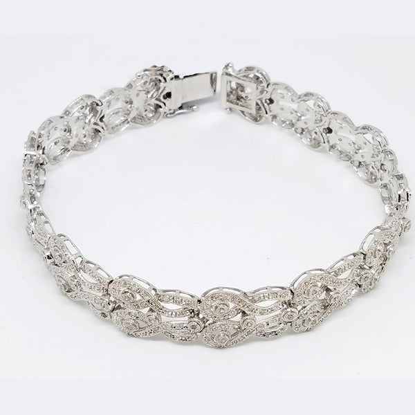 14 k White Gold Diamond Swirling Braided Bracelet