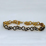 Swirling 14k Yellow Gold and Diamond Bracelet With Black Accent