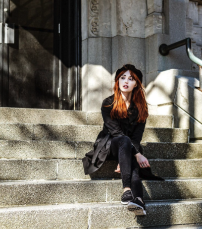 Woman in All Black Sitting On Steps