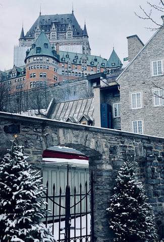 Beautiful architecture covered in snow on a foggy day in Quebec City