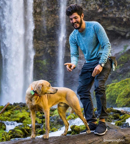A man and a dog exploring the outdoors as a covid friendly vacation