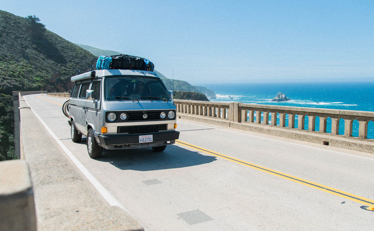 van driving down the road on the california coast