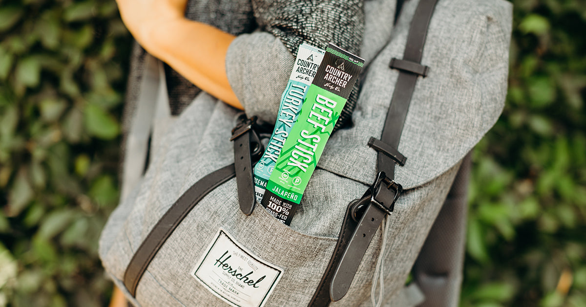 Country Archer beef stick and turkey stick in a backpack portable snack