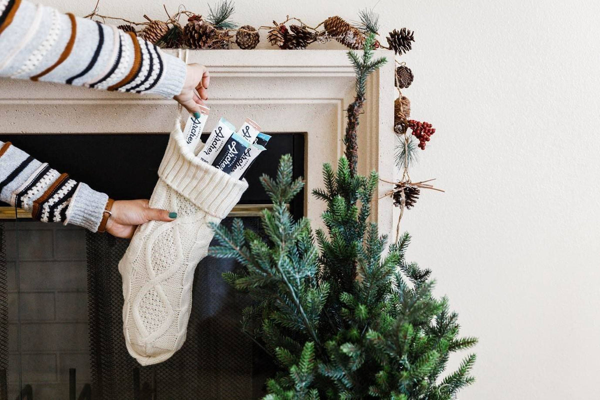 Christmas stocking filled with Country Archer Meat Sticks- lifestyle carousel image