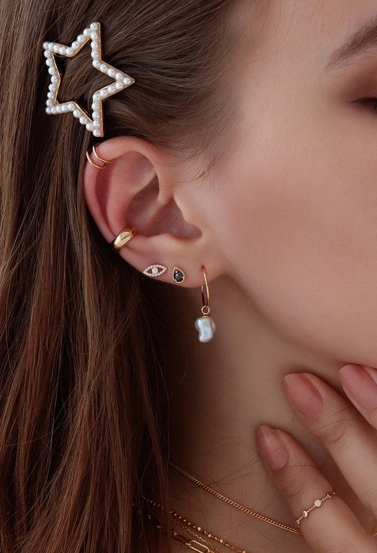 Curated ear stacks with pearl and gold piercings