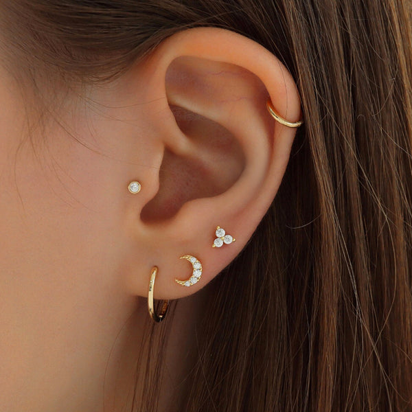 dainty stacked ear piercings in solid gold
