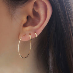tiny 6mm hugging hoop earrings in second hole and third hole
