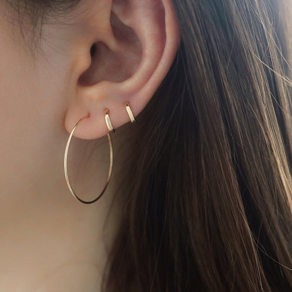 tiny 6mm huggie hoop earrings made from 14k gold