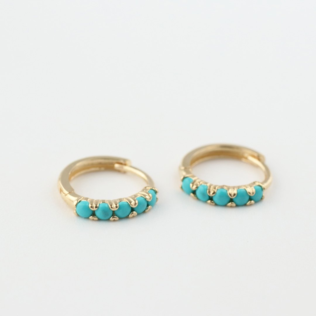 14k gold huggie hoops earring featuring turquoise stones