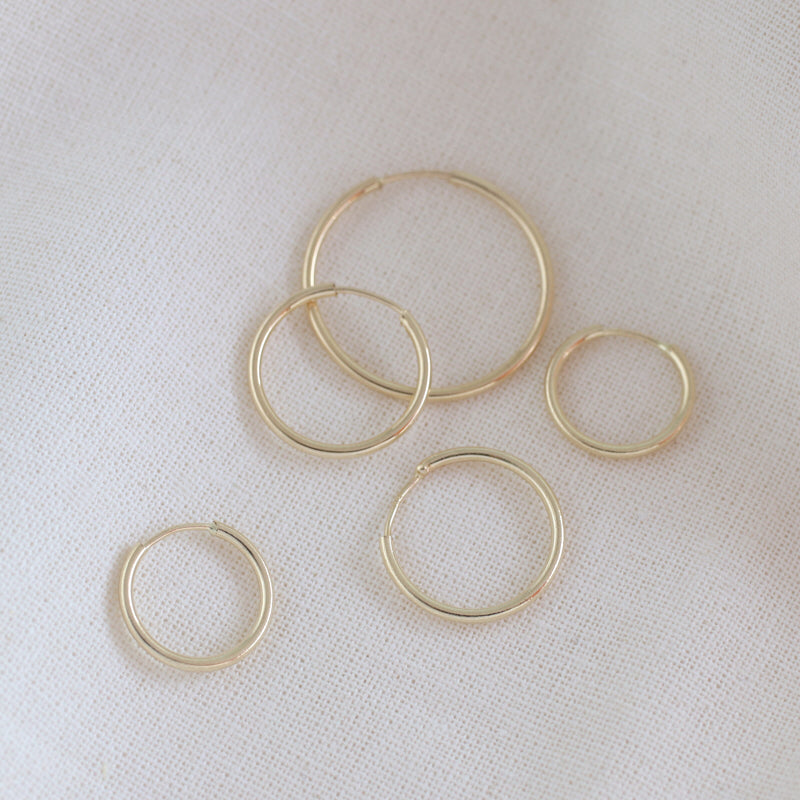seamless hoop earrings made from 14k gold