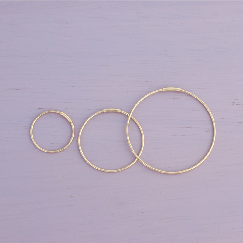 14k gold endless hoops in small, medium and large