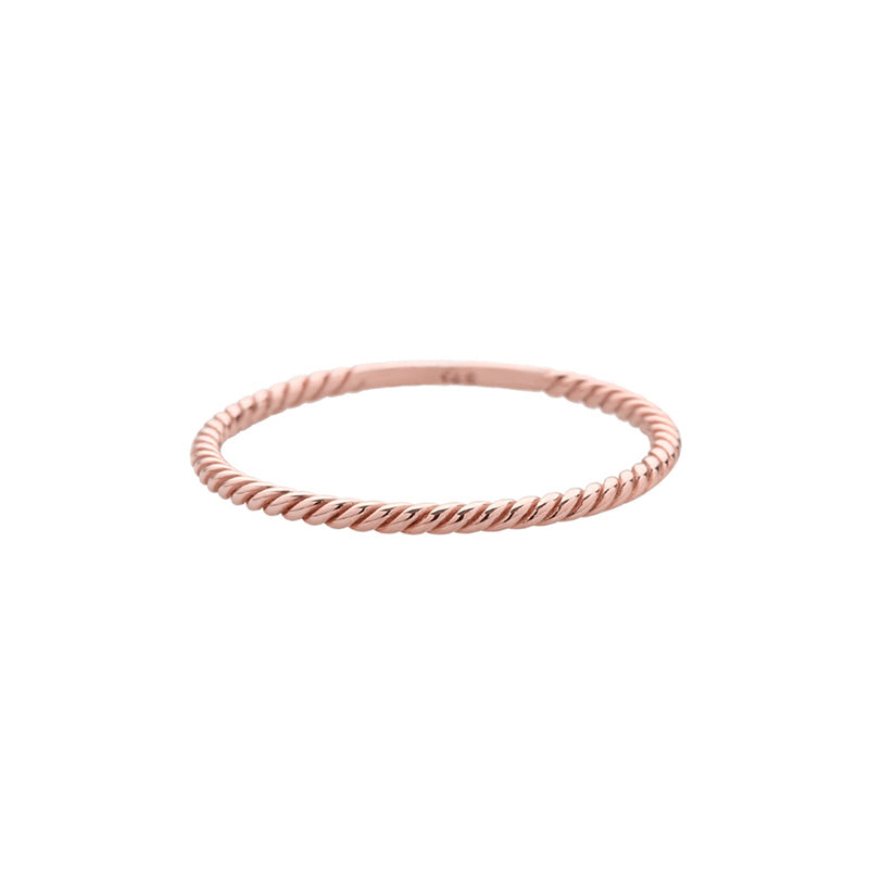twisted staker ring made from solid 14k rose gold