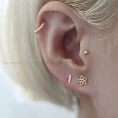 14k gold ball labret in tragus piercing