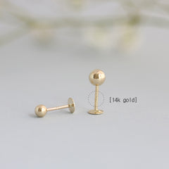 14k gold labret piercing with 3mm ball and 4mm ball
