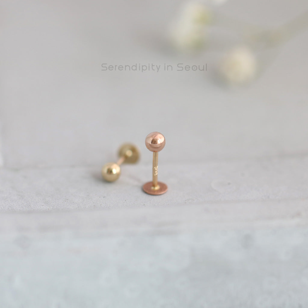 14k rose gold ball labret piercing