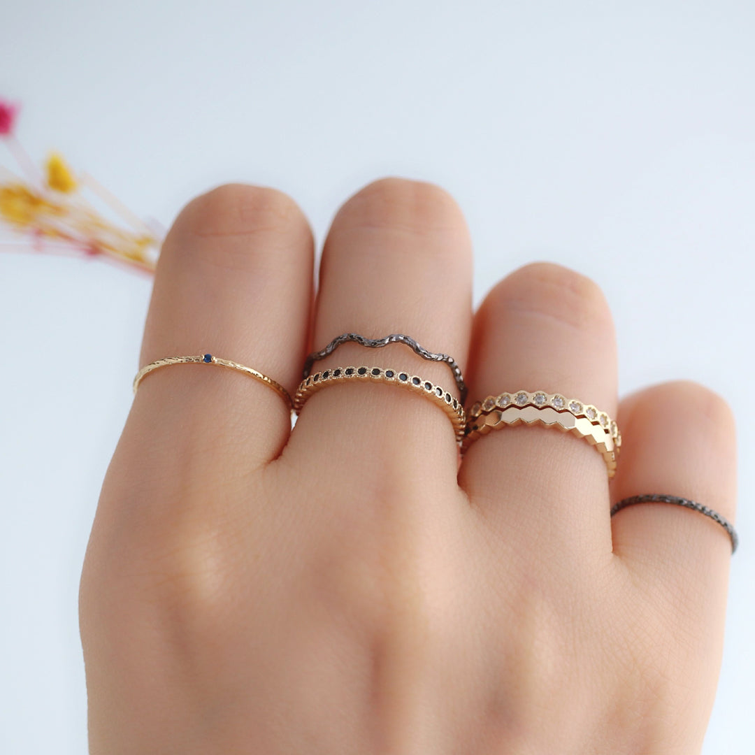 gold and black stacking rings