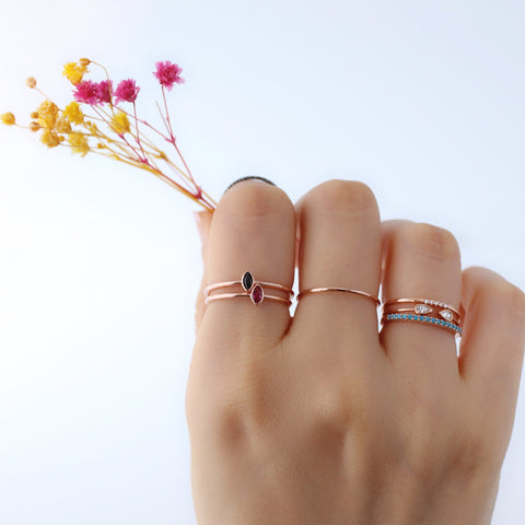 dainty stacking sterling silver rings with ruby and black CZ