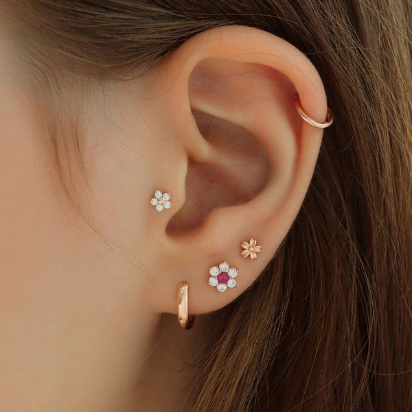 flower cartilage labret piercings in 14k gold