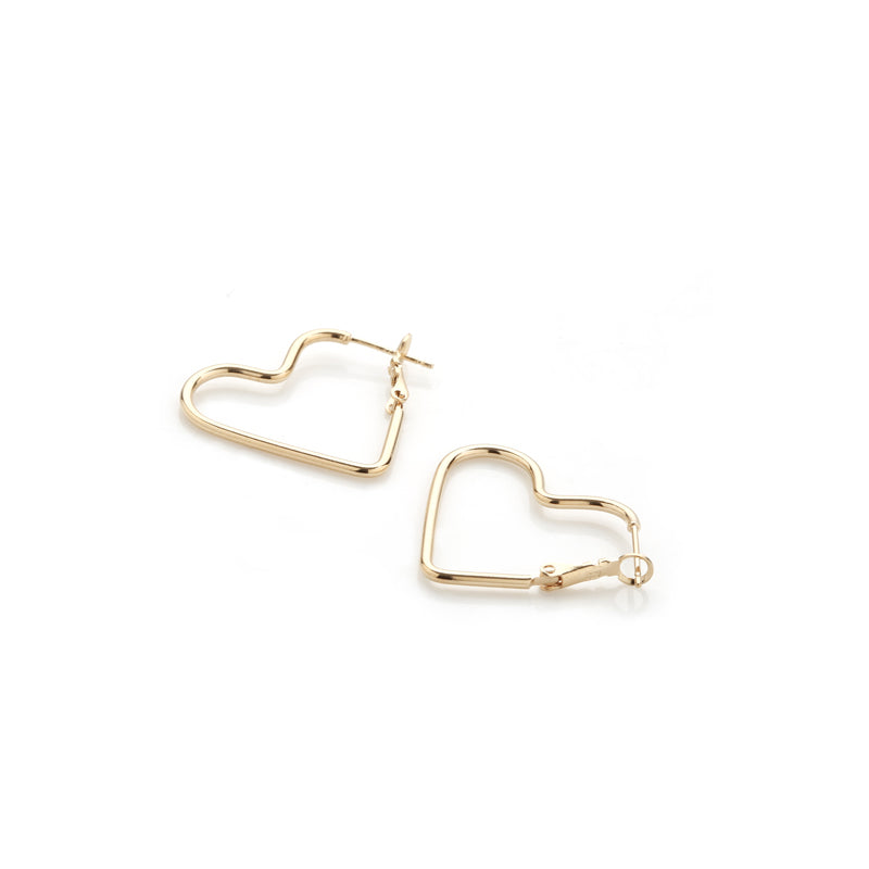 a pair of gold heart hoop earrings