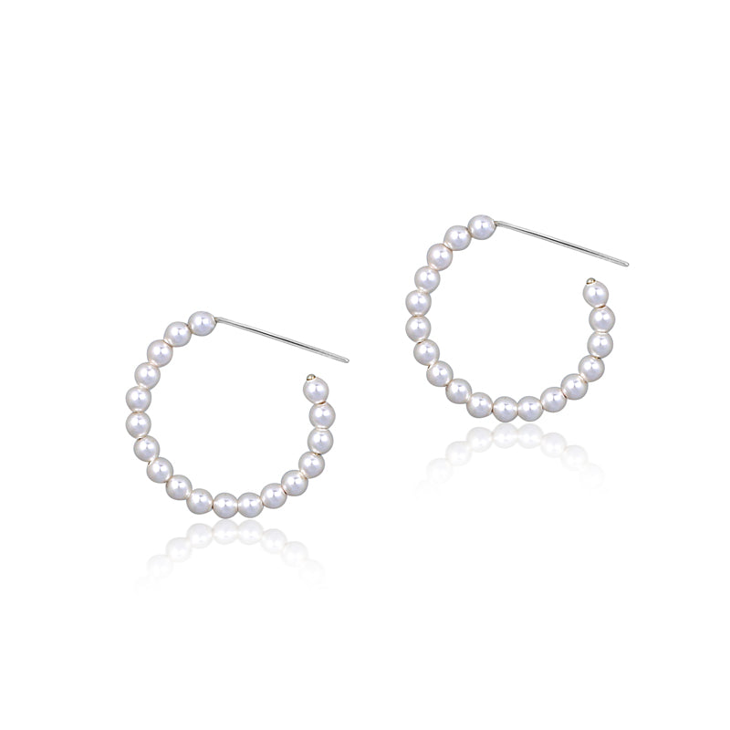 pearl hoop earrings made from sterling silver