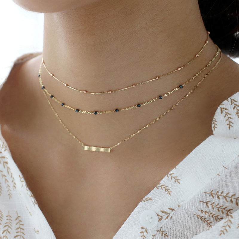 layered gold choker necklaces