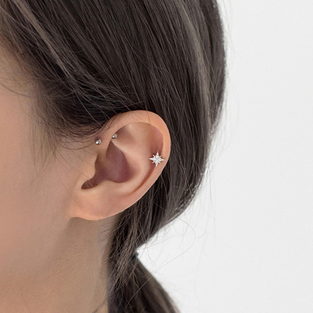 north star earrings on cartilage piercing