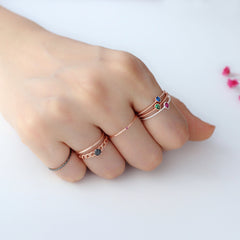 delicate stacking rings in rose gold and silver