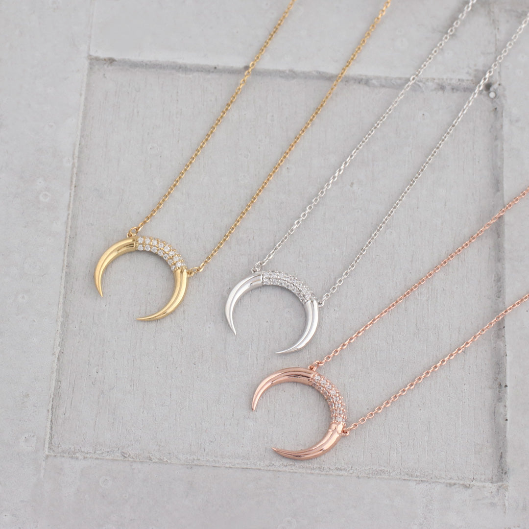 crescent moon necklaces in silver, gold and rose gold