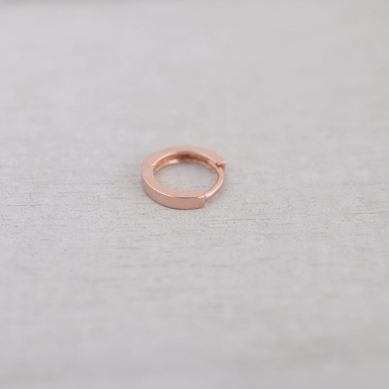 tiny flat huggie hoop earring in rose gold