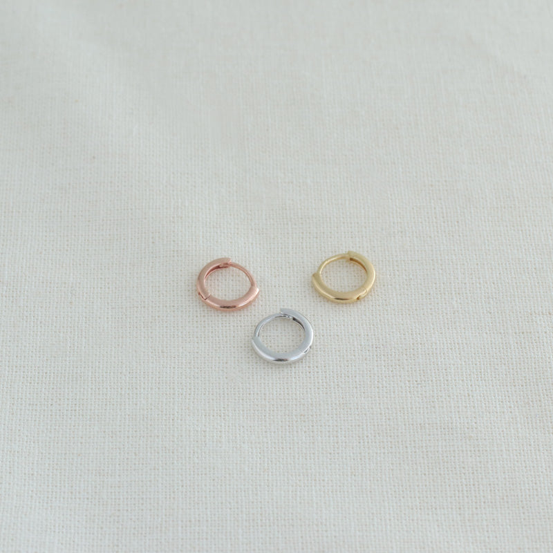 tiny huggie hoop earrings in silver, gold and rose gold