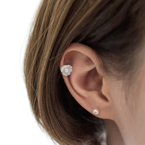white flower stud on upper ear piercing