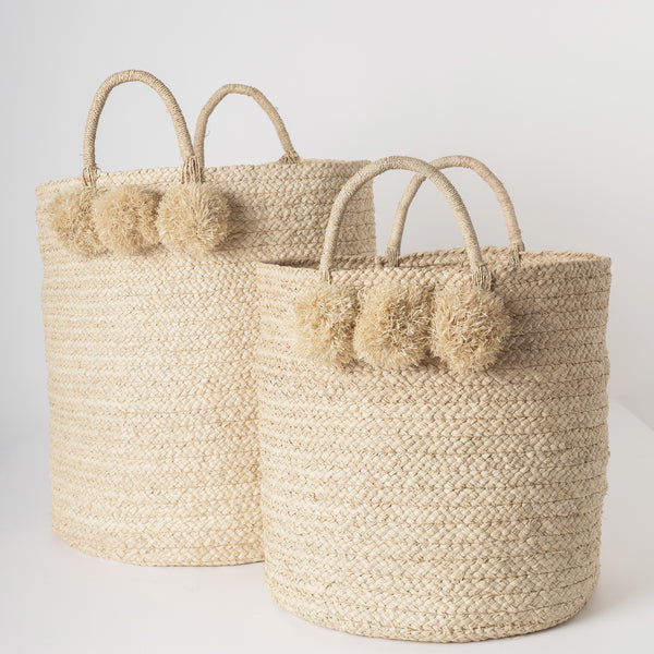 raffia storage basket with pom poms