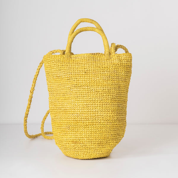 woven yellow raffia bag