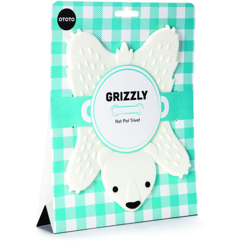 How lovely is this! This fun play on a bear skin rug is really cute addition to a kitchen which will save your worktops from heat damage. Choose from brown or white! This silicon trivet is very easy to clean and its both practical and very fun.