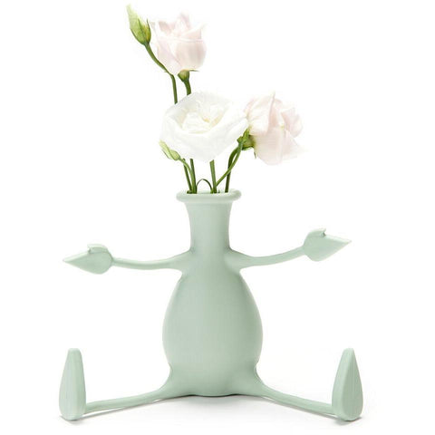 We adore this cute little plant pot. It is so unique - you can bend the arms and legs to whatever position you like, even hang it from a shelf...whatever takes your fancy! We love it's subtle mint green colour too, it's earthy colour doesn't take away from the form factor. Durable, easy to clean and utterly unique - we're sure you'll love this plant pot as much as we do!