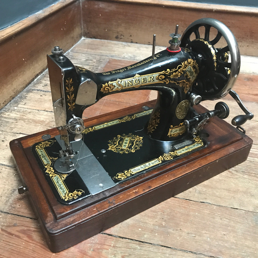 SOLD - Vintage Singer Sewing Machine with case