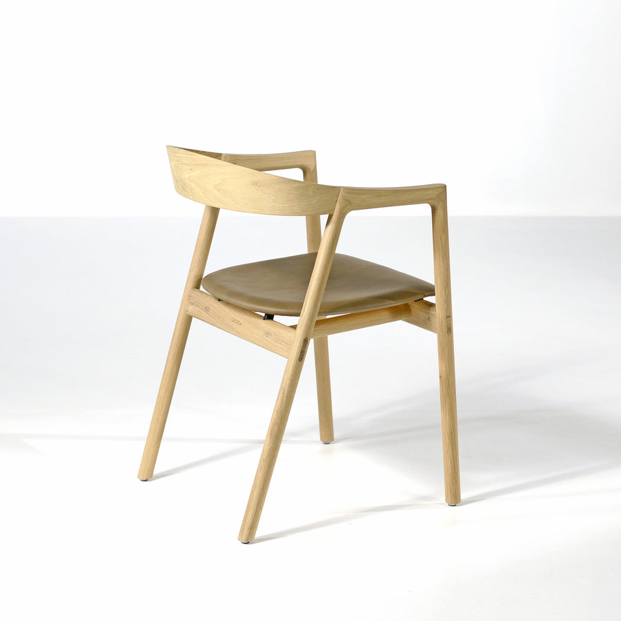 Gazzda Muna Chair in solid Oak and Dakar Leather Stone, back turned | © Spencer Interiors