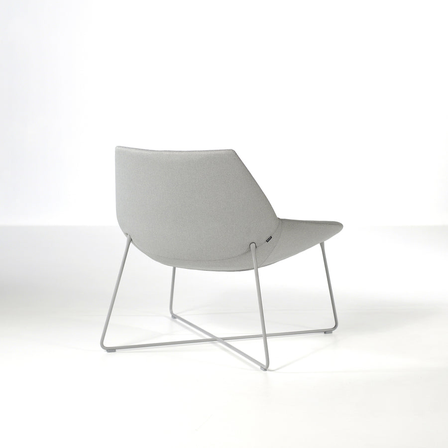 Inclass Dunas XL,  Low Back Rod Base Armchair, back turned, © Spencer interiors Inc.